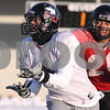 Kyle Bursaw – kbursaw@daily-chronicle.com<br /> <br /> Northern Illinois wide receiver Da'Ron Brown (4) hauls in a pass as Northern Illinois cornerback Tommy Davis (20) covers him during practice at Huskie Stadium on Friday, Dec. 10, 2010.