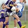 Beck Diefenbach  -  bdiefenbach@daily-chronicle.com<br /> <br /> Hinckley-Big Rock's Sarah Paver (23, right) and Mendota's Layne Becker (21) battle for control of the ball during the first half of the game at H-BR in Hickley, Ill., on Tuesday May 18, 2010.
