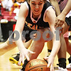 Rob Winner – rwinner@daily-chronicle.com<br /> DeKalb's Emily Bemis tries to control a loose ball in the first half during the Castle Challenge on Friday January 29, 2010 in DeKalb, Ill.