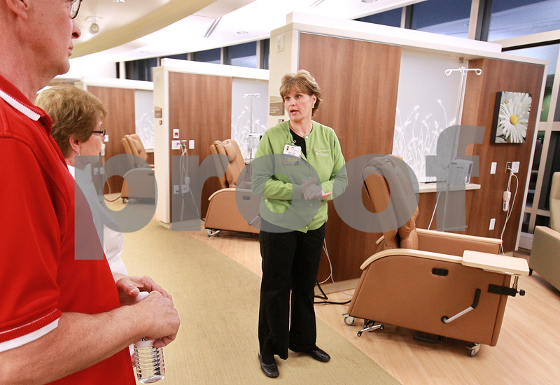 Kyle Bursaw — kbursaw@daily-chronicle.com<br /> <br /> Registered Nurse Barb Schultz points out features of the treatment bays to those touring the new Kishwaukee Cancer Care Center in DeKalb, Ill. during an open house on Nov. 10, 2010.