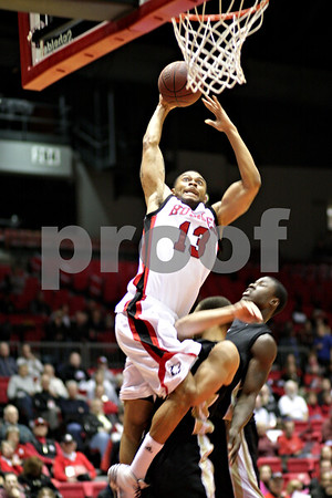 Beck Diefenbach  -  bdiefenbach@daily-chronicle.com<br /> <br /> Northern Illinois' Xavier Silas (13, top) shoots the ball above Western Michigan's David Brown (25) during the first half of the game at the Convocation Center at NIU in DeKalb, Ill., on Wednesday Jan. 13, 2010.
