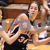 Kyle Bursaw – kbursaw@daily-chronicle.com<br /> <br /> DeKalb's Rachel Torres looks to pass against the defense of Hampshire's Jessie Van Dorin. Hampshire defeated DeKalb 46-38 at DeKalb High School on Saturday, Nov. 27, 2010 during the Turkey Toss-Up tournament.