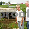 Beck Diefenbach - bdiefenbach@daily-chronicle.com<br /> <br /> Local residents Dorothy and Richard Krabbe pose next to the empty spot where a bridge collapsed on Keslinger Road two years ago in Afton Township.