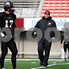 Rob Winner – rwinner@daily-chronicle.com<br /> <br /> NIU quarterbacks coach Jim Zebrowski (center) works with the quarterbacks during practice at Huskie Stadium in DeKalb, Ill. on Thursday April 8, 2010.