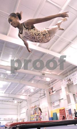 Kyle Bursaw – kbursaw@daily-chronicle.com<br /> <br /> Anita Bell, a sophomore on the DeKalb gymnastics team, flips through the air while practicing on a tumble track at Energym in Sycamore, Ill. on Tuesday, Dec. 21, 2010.