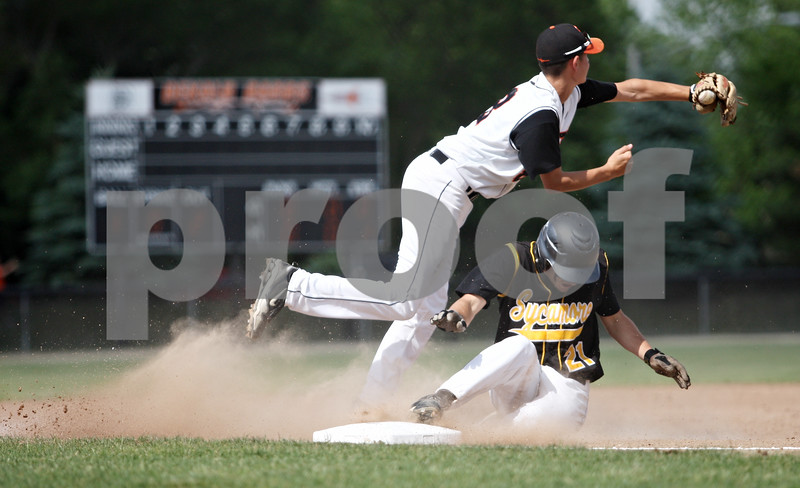 Rob Winner – rwinner@daily-chronicle.com<br /> <br /> Sycamore's Trevor Mathey slides safely into third base before the tag of DeKalb's Luke Hayes in the first inning during the IHSA Class 3A DeKalb Sectional semifinal on Wednesday June 2, 2010 in DeKalb, Ill. Mathey knocked in two with his triple.