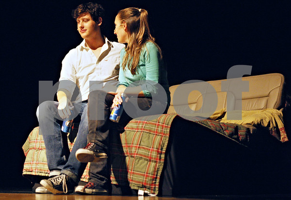 """Rob Winner – rwinner@daily-chronicle.com<br /> <br /> Kurt Proepper (left) and Emma Olson  act out a scene involving alcohol and sex during a musical production called """"Stand Up!"""" at Sycamore High School on Wednesday afternoon."""