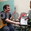 Beck Diefenbach  -  bdiefenbach@daily-chronicle.com<br /> <br /> Teacher Quentin Dover (left) goes over sheet music with Nicholas Chen, 8, of DeKalb, Ill., during a guitar basics lesson at the Northern Illinois University Community School of Music in DeKalb, Ill., on Wednesday March 17, 2010.