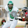 Rob Winner – rwinner@daily-chronicle.com<br /> <br /> North Dakota quarterback Jake Landry rolls out of the pocket while being pursued by Northern Illinois linebacker Tyrone Clark during the first quarter in DeKalb, Ill. on Saturday September 11, 2010.