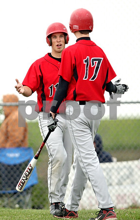 Beck Diefenbach  -  bdiefenbach@daily-chronicle.com<br /> <br /> Indian Creek Reece Bend (11, left) is congratulated by Josh Lazzarotto (17, right) after Bend scored a run during the fifth inning of the game against Fulton at Indian Creek High School in Shabbona, Ill., on Monday May 17, 2010.