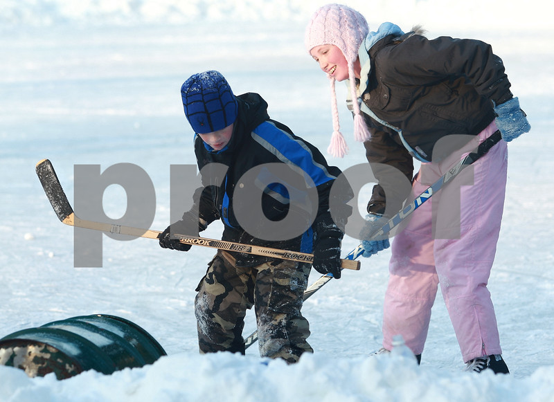 Kyle Bursaw – kbursaw@daily-chronicle.com<br /> <br /> Thomas, 8, and Kristen Kennedy, 11, battle with each other to get a puck into a metal drum on the ice at Lions Park where they were facing off and skating on Tuesday, Dec. 28, 2010. The National Weather Service predicts that there will be areas of fog before 9 a.m. Wednesday; otherwise, it will be party sunny with a high temperature of 32 degrees. There is a slight chance of rain or freezing rain Wednesday night, with areas of fog and a low of 30 degrees.