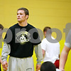 Rob Winner – rwinner@daily-chronicle.com<br /> <br /> Alex Nelson watches his team during drills at wrestling practice on Tuesday afternoon in Sycamore. This is Nelson's first year as the head coach of the Spartans.