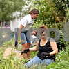 Rob Winner – rwinner@daily-chronicle.com<br /> <br /> Day of Caring volunteers Heather Fritsch (front) and Darci Friedlund remove weeds from the yard of the DeKalb Area Women's Center in DeKalb, Ill. on Thursday September 16, 2010.