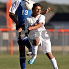 Beck Diefenbach – bdiefenbach@daily-chronicle.com<br /> <br /> Genoa-Kingston's Adrian Tijerina (5, right) and Rockford Christian's Stephen Villacorta (13) collide while fighting for the ball during the first half of the game at G-K High School in Genoa, Ill., on Thursday Sept. 30, 2010. G-K defeated Rockford Christian 1 to 0.