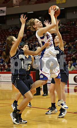 Beck Diefenbach - bdiefenbach@daily-chronicle.com<br /> <br /> Hinckley-Big Rock's Tess Godhardt grabs a rebound during overtime of the IHSA Class 1A semifinal game against Ridgewood at the Red Bird Arena on the campus of Illinois State University in Bloomington, Ill., on Friday Feb. 26, 2010.