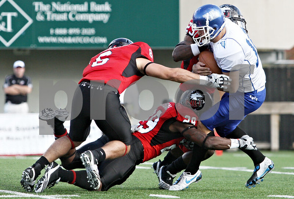 Rob Winner – rwinner@daily-chronicle.com<br /> <br /> Buffalo kicker Jacob Schum is tackled after fumbling a snap during a punt attempt in the second quarter in DeKalb, Ill. on Saturday October 16, 2010.