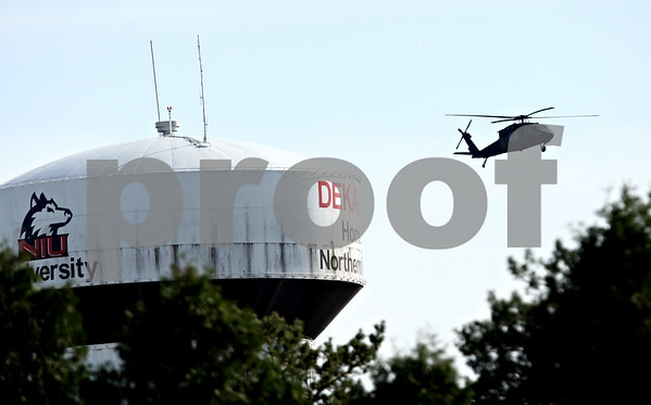 Beck Diefenbach  -  bdiefenbach@daily-chronicle.com<br /> <br /> A National Guard helicopter fly past the NIU water tower in DeKalb, Ill., on Friday April 16, 2010.