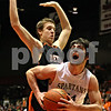 Rob Winner – rwinner@daily-chronicle.com<br /> Sycamore's Harlan Johnson (front) moves past DeKalb defender Chris Calbow during the second quarter of the Castle Challenge on Friday January 29, 2010 in DeKalb, Ill.
