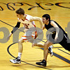 Rob Winner – rwinner@daily-chronicle.com<br /> DeKalb's Dylan Donnelly (left) creates a turnover and goes to the basket while Sycamore's Josh Reed trails during the second quarter. DeKalb went on to defeat Sycamore, 53-43, on Saturday February 20, 2010 in DeKalb, Ill.