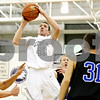 Rob Winner – rwinner@daily-chronicle.com<br /> <br /> Kaneland forward Daniel Helm (40) puts up two in the first quarter during the Christmas Classic in Plano on Monday while facing Hinckley-Big Rock. Kaneland went on to defeat Hinckley-Big Rock, 66-33.