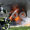 Beck Diefenbach  -  bdiefenbach@daily-chronicle.com<br /> <br /> DeKalb firefighters extinguish the fire in a single room without a sprinkler system during a demonstration by the DeKalb Fire Department in support of sprinkler systems at DeKalb Taylor Municipal Airport in DeKalb, Ill., on Monday May 3, 2010. Another room equipped with a sprinkler system was also ignited and