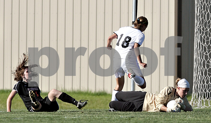 Beck Diefenbach  -  bdiefenbach@daily-chronicle.com<br /> <br /> Sycamore goal keeper Sarah Fischer (right) grabs a shot by Freeport's Julia Luecke (11, left) during the first half of the IHSA Class 2A sectional final game at Hampshire High School in Hampshire, Ill., on Friday May 28, 2010.