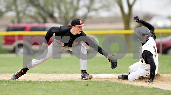 Beck Diefenbach  -  bdiefenbach@daily-chronicle.com<br /> <br /> DeKalb's Brian Sisler (22, left) tags out Sycamore's Danny Schroeder (3, right) during the fourth inning of the game at Sycamore Park in Sycamore, Ill., on Thursday April 8, 2010.