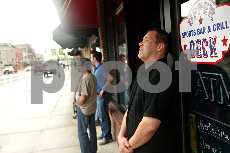 Beck Diefenbach  -  bdiefenbach@daily-chronicle.com<br /> <br /> Dan Bowers, director of operations at Upper Deck Sports Bar and Grill, stands outside the DeKalb restaurant after it lost power Friday June 18, 2010