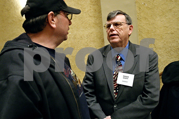 Rob Winner – rwinner@daily-chronicle.com<br /> Sheriff Roger Scott (left) listens to John Zingale's concerns at a meet and greet during the DeKalb Chamber of Commerce's Candidates' Night at the Egyptian Theatre in DeKalb, Ill. on Tuesday January 19, 2010.