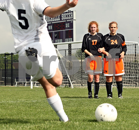 Beck Diefenbach  -  bdiefenbach@daily-chronicle.com<br /> <br /> DeKalb's Danielle Dlabal (17) and Karen Lehan (24) stand together as Sycamore's Krista Koeplin (5) winds up for a free kick during the first half of the IHSA Class 2A Rochelle Regional Championship at Rochelle Township High School in Rochelle, Ill., on Friday May 21, 2010. Sycamore defeated DeKalb 2 to 1.