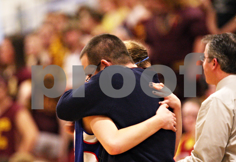 Beck Diefenbach  -  bdiefenbach@daily-chronicle.com<br /> <br /> Hinckley-Big Rock's Tess Godhardt is welcomed back to the bench by head coach Greg Burks during the fourth quarter of the IHSA Class 1A Super Sectional championship game against Stockton at Judson University in Elgin, Ill., on Monday Feb. 22, 2010.