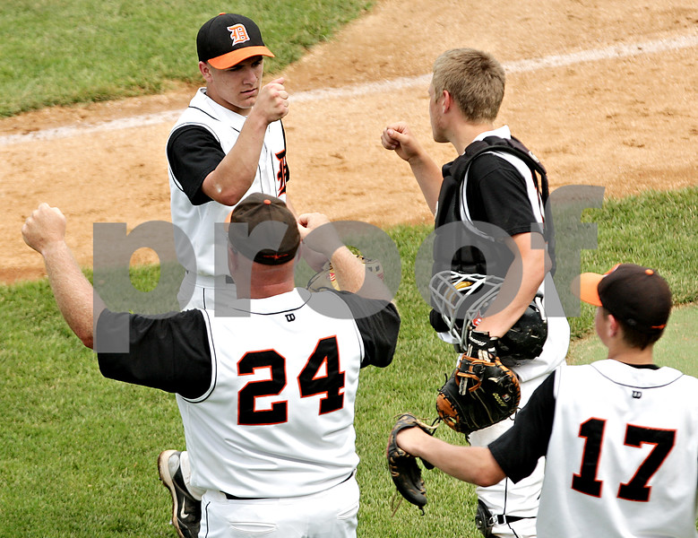 Beck Diefenbach  -  bdiefenbach@daily-chronicle.com<br /> <br /> DeKalb pitcher Jake Lemay (top left) is congratulated at the middle of the fifth inning of the IHSA Class 3A State Semifinal Game against Marian Central in Joliet, Ill., on Friday June 11, 2010.