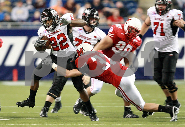 Kyle Bursaw – kbursaw@daily-chronicle.com<br /> <br /> Miami (OH) defensive back Pat Hinkel (37) brings down Northern Illinois running back Ricky Crider (22) <br /> in the MAC Championship game. The Miami (Ohio) Redhawks defeated the the Northern Illinois Huskies 26-21 at Ford Field in Detroit, Mich. on Friday, Dec. 3, 2010.