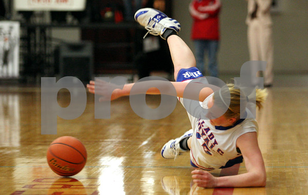 Rob Winner – rwinner@daily-chronicle.com<br /> Hinckley-Big Rock's Jes Meyer tries to keep a loose ball inbounds during the first half of Tuesday's sectional game against  Ottawa Marquette at Mooseheart.