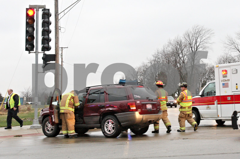 Rob Winner – rwinner@daily-chronicle.com<br /> <br /> Emergency personnel respond to a vehicle accident at the intersection of Peace and Bethany roads in Sycamore on Wednesday afternoon.
