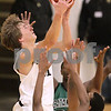 Kyle Bursaw – kbursaw@daily-chronicle.com<br /> <br /> Sycamore's Tom Paulson shoots over Catamount's defenders. The Sycamore Spartans defeated the Gary Comer College Prep Catamounts  51-48 during the Leland G. Strombom Tournament on Friday, Nov. 26, 2010