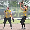 Rob Winner – rwinner@daily-chronicle.com<br /> <br /> Sycamore's Rachel Lesorgen (left) backs off as Anna Buzzard (30) calls a ball for the final out during the IHSA Class 3A DeKalb Sectional semifinal on Wednesday June 2, 2010 in DeKalb, Ill.