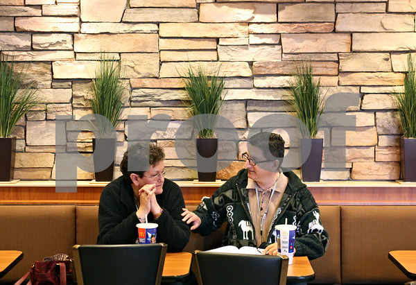 Beck Diefenbach  -  bdiefenbach@daily-chronicle.com<br /> <br /> Richard Salazar (right) and his fiance Marlene French talk while having soft drinks at McDonald's in Sycamore, Ill., on Friday March 19, 2010.