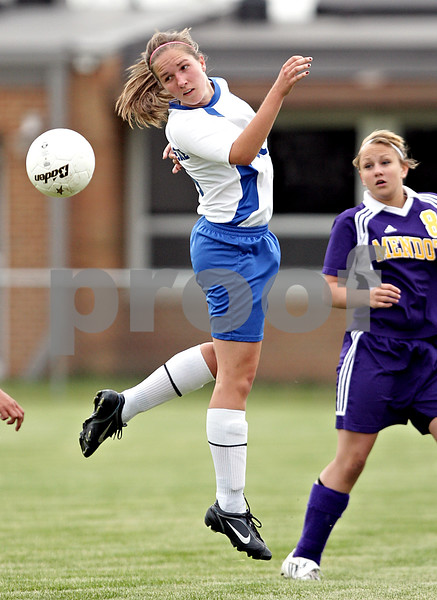 Beck Diefenbach  -  bdiefenbach@daily-chronicle.com<br /> <br /> Hinckley-Big Rock's Hanna VanderMoere (16) leaps to head the ball during the first half of the game against Mendota at H-BR in Hinckley, Ill., on Tuesday May 18, 2010.