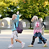 Rob Winner – rwinner@daily-chronicle.com<br /> <br /> 7-year-old Gabrie Gozder (left) waves to a school bus while crossing Depot Street along Washington Street during participation in National Walk to School Day in Somonauk, Ill., on Wednesday Oct. 6, 2010.
