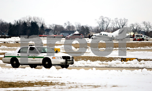 Rob Winner – rwinner@daily-chronicle.com<br /> Emergency personnel respond to a plane crash at DeKalb Taylor Municipal Airport on Tuesday March 2, 2010 in DeKalb, Ill.