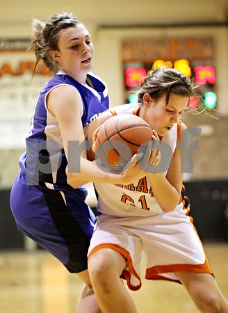Beck Diefenbach  -  bdiefenbach@daily-chronicle.com<br /> <br /> Geneva's Lauren Wicinski (40, left) and DeKalb's Kelli Grace (21) fight for the ball during the fourth quarter of the game at DeKalb High School, in DeKalb, Ill., on Friday Jan. 5, 2010. Geneva defeated DeKalb 44 to 41.