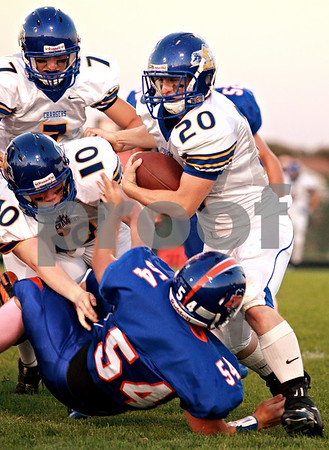 Beck Diefenbach  -  bdiefenbach@daily-chronicle.com<br /> <br /> Aurora Central Catholic running back Zach Tobin (20, right) is tackled by Genoa-Kington lineman Austin Bankson (54) during the first quarter of the game at Genoa-Kingston High school in Genoa, Ill., on Friday Aug. 27, 2010.