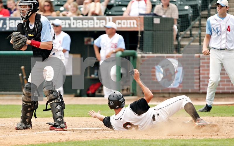 Beck Diefenbach  -  bdiefenbach@daily-chronicle.com<br /> <br /> DeKalb's Trenton Sopko (9) slides into home plate during the first inning of the IHSA Class 3A State Semifinal Game against Marian Central in Joliet, Ill., on Friday June 11, 2010.