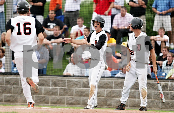 Rob Winner – rwinner@daily-chronicle.com<br /> <br /> Frank Petras (center) reacts as Jake Jouris (16) scores the second run of the sixth inning putting DeKalb up 4-2 during the IHSA Class 3A Augustana College Super-Sectional on Monday June 7, 2010. DeKalb defeated Galesburg, 8-4.