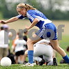 Beck Diefenbach  -  bdiefenbach@daily-chronicle.com<br /> <br /> Rosary's Tara Early (23, top) nearly falls over Sycamore's Krista Koeplin (5) during the second half of the IHSA Class 2A Hampshire Sectional Semi-final game at Hampshire High School in Hampshire, Ill., on Tuesday May 25, 2010. Sycamore defeated Rosary 3 to 1.
