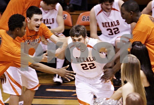 Beck Diefenbach  -  bdiefenbach@daily-chronicle.com<br /> <br /> Dekalb's Brian Sisler (22) enters the court before the start of the game against Rochelle at DeKalb High School  in DeKalb, Ill., on Friday Jan. 8, 2010.
