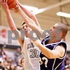 Beck Diefenbach - bdiefenbach@daily-chronicle.com<br /> <br /> Hampshire's Pat Doumoulin (30, right) and Kaneland's Chaon Denlinger (30, left) battle for a rebound during the first half of the IHSA Class 3A semifinal regional game at Kaneland High School in Maple Park, Ill., on Wednesday March 3, 2010.