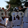 Beck Diefenbach  -  bdiefenbach@daily-chronicle.com<br /> <br /> DeKalb's Matt Godinsky (14, center) is congratulated after hitting a home run during the second inning of the game against Sycamore at DeKalb High School in DeKalb, Ill., on Friday April 9, 2010.