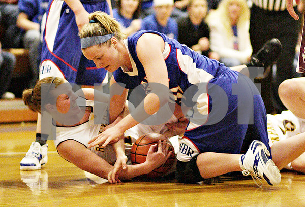 Beck Diefenbach - bdiefenbach@daily-chronicle.com<br /> <br /> Hinckley-Big Rock's Jenna Thorp (top) battle for the ball with Stockton's Jessica Burnner (11) during the second half of the the IHSA Class 1A Super Sectional championship game at Judson  University in Elgin, Ill., on Monday Feb. 22, 2010.